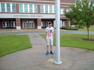 The boy who stood at the flagpole alone